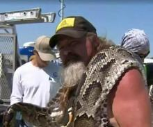 "Dusty ""Wildman"" Crum with his 16-foot-10 python"