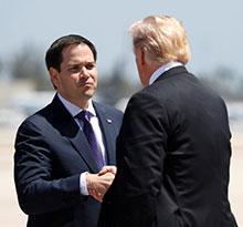 Sen. Marco Rubio greets the president in Miami