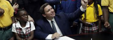 Ron DeSantis in Miami Gardens last May, at the voucher bill signing