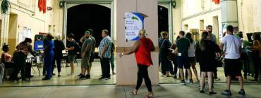 Voters wait to cast ballots in Miami on Nov. 6, 2018