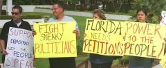 (photo of petition protesters) Credit: AP/SSN archives