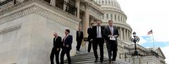 U.S. House members exit the Capitol Thursday.